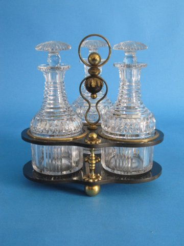 Three Glass Decanter & Black Lacquered Papier Mache & Ormolu Tantalus.George IV, circa 1825. - Click to enlarge and for full details.