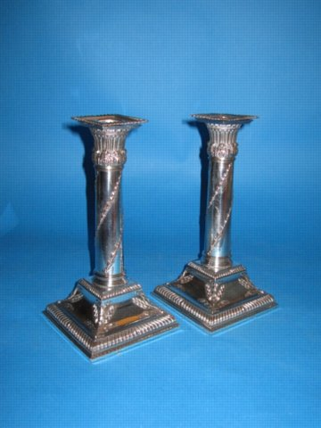 A Pair of Small George III Candlesticks, circa 1785. Possibly by Winter & Co.,  - Click to enlarge and for full details.