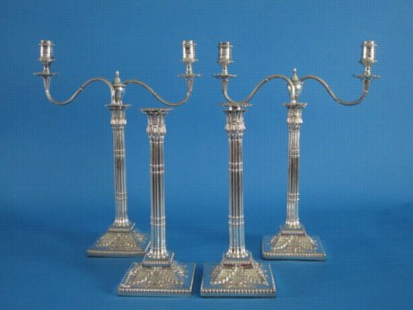 A Suite of George III  Pair of Candelabra & Two Candlesticks, circa 1775. - Click to enlarge and for full details.