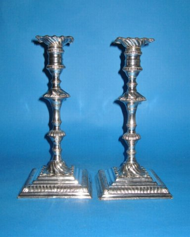 A Pair of George III Candlesticks by Tudor & Co., circa 1760. - Click to enlarge and for full details.