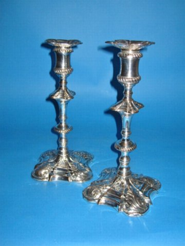 A PAIR OF GEORGE III CANDLESTICKS BY TUDOR & CO., CIRCA 1765 - Click to enlarge and for full details.