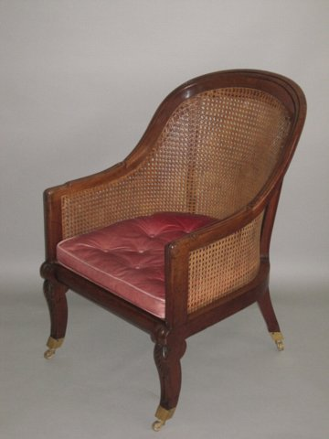 REGENCY MAHOGANY BERGERE LIBRARY CHAIR. - Click to enlarge and for full details.