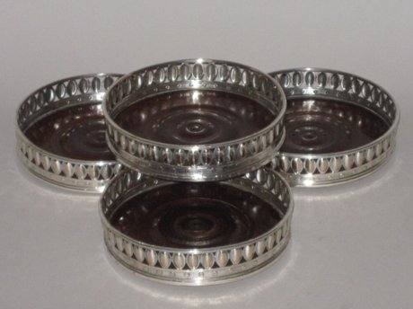 SET OF FOUR 18TH CENTURY OLD SHEFFIELD PLATE SILVER WINE COASTERS, CIRCA 1780. - Click to enlarge and for full details.