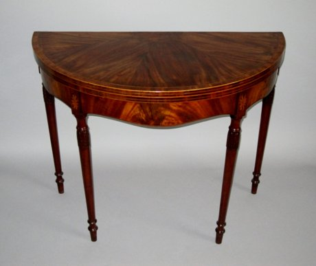 GEORGE III MAHOGANY DEMI LUNE CARD TABLE. CIRCA 1790. - Click to enlarge and for full details.
