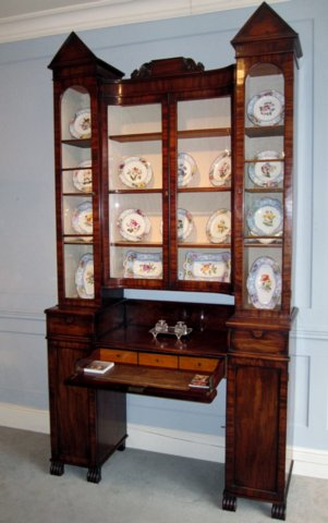 A MAHOGANY SECREATIRE BOOKCASE/CHINA CABINET. CIRCA 1830 - Click to enlarge and for full details.